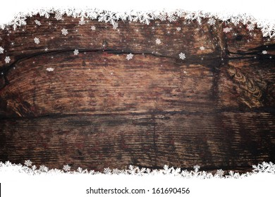 Snow stars on wooden background