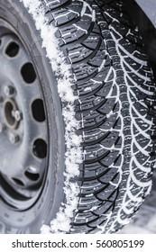 snow tire on snowy roadway