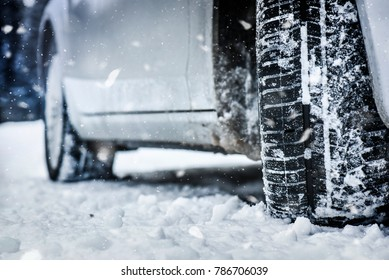 Snow tire in winter road. Winter tire on snow road. Car tire on winter