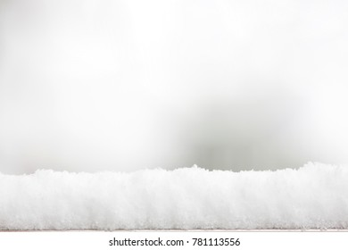 Snow top on blur white snowfall background for display or montage product