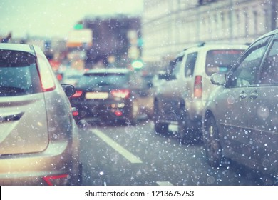 snow transport road city / landscape in a night city in winter, cars on the road in traffic jam in cold weather, snow