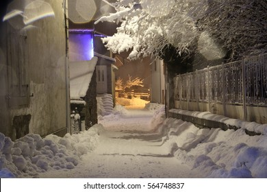 Snow in village street at night in Pyrenees