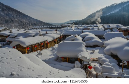 Snow village at sunny day in Mohe County, Northernmost China.