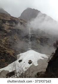 Snow waterfall at Annapurna base camp - Nepal, Himalayas