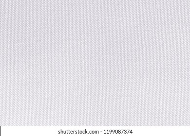Snow white canvas background. Surface of fabric texture in white winter color.