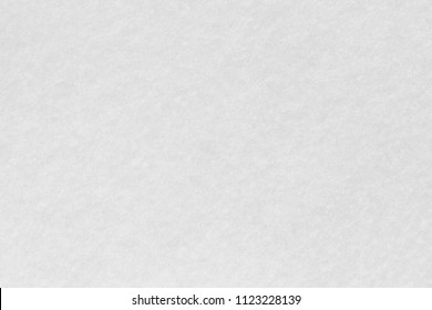Snow white felt background. Surface of fabric texture in white winter color.