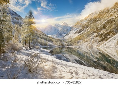 Snow winter mountain lake bright and early, Russia, Siberia, Altai mountains, Chuya ridge.