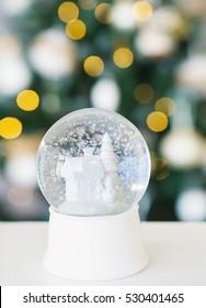 Snowball on Christmas tree lights background, holidays season