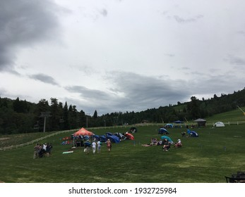 Snowbird, UT, USA - 30 June 2019: Patrons gather under a gloomy sky for the Snowbird Cool Air Summer Concert Series, a series of free concerts and Snowbird Ski Resort in Utah.