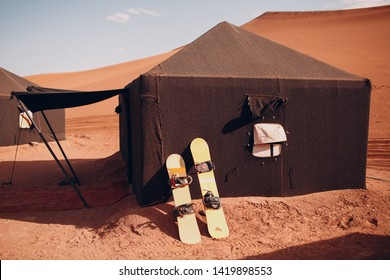 Snowboard in the desert. Vacation and activity concept. Sandboarding concept.
