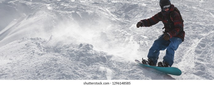 snowboard freerider on the slope