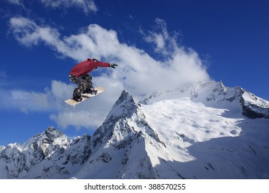 Snowboard jump on mountains. Extreme sport.