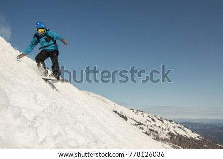 f493b4ffb5c7 snowboard man have fun and jumping in snow. Winter sport holiday mountains  sky resort