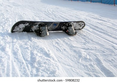 A snowboard on snow representation of a dangerous fall