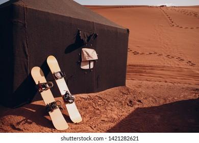 Snowboard sandboard in the desert. Vacation and activity sandboarding concept.