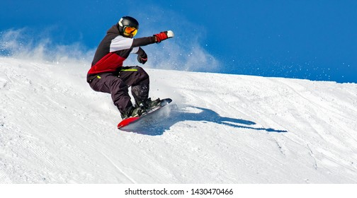 Snowboarder in action on the track with fresh snow