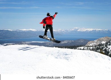 Snowboarder enjoying a view at Lake Tahoe, California