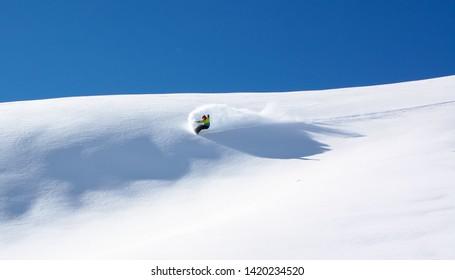 Snowboarder in fine white powder snow