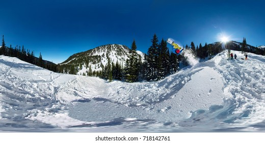 Snowboarder freerider jumping from snow ramp. Spherical 360 vr180 panorama.