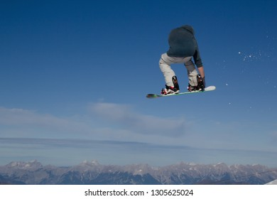 Snowboarder gets airborne after jumping over a kicker in the Kitzsteinhorn Funpark in Austria in the Alps in Europe