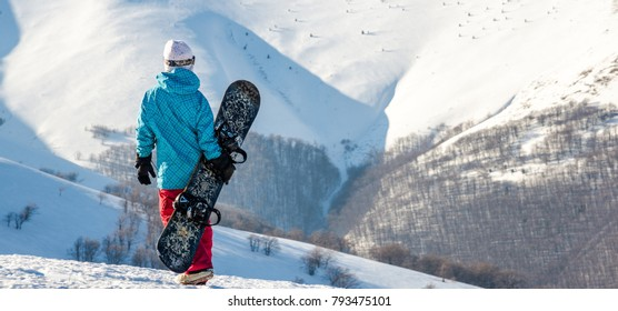 snowboarder girl standing with snowboard,
