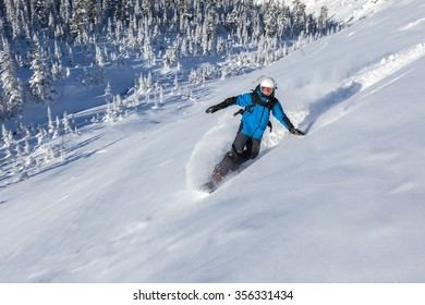 Snowboarder go down on mountain slope