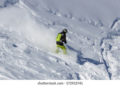 Snowboarder having fun skiing offside on the snowy mountain of the Hintertuxer Glacier (Tuxer Ferner) in Tyol, Austria