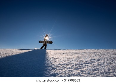 snowboarder hiking through deep fresh snow