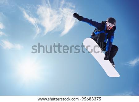 5da3a0adc375 Snowboarder Jumping Against Blue Sky Stock Photo (Edit Now) 95683375 ...