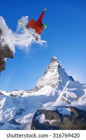 Snowboarder jumping against Matterhorn in Switzerland