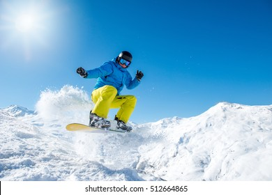 Snowboarder jumping in the mountains in winter
