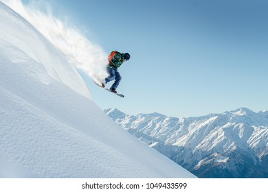 snowboarder jumping on a steep mountainside