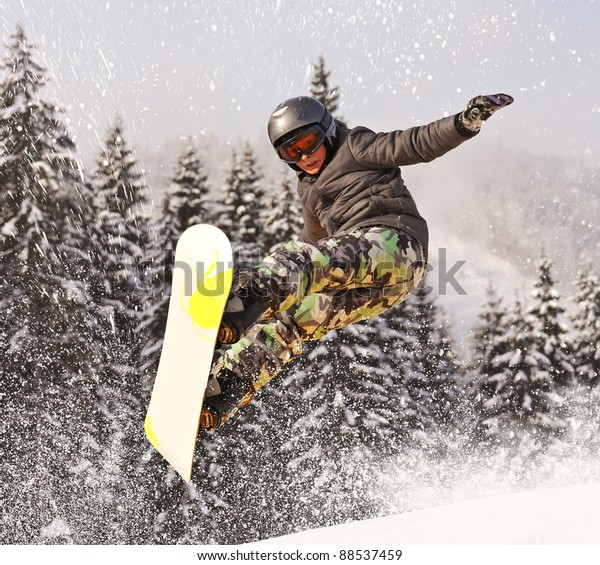 Snowboarder jumping through
