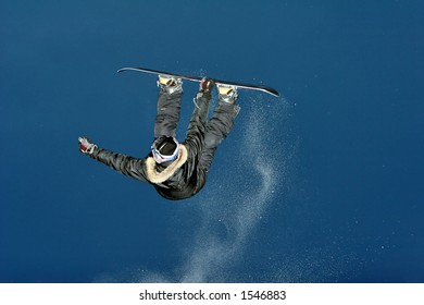 Snowboarder jumps and do some atractive tric.