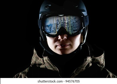 snowboarder in the mask and helmet on a black background