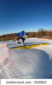 a snowboarder on a curved rail