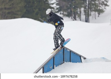 A snowboarder on a ramp at the Wisp Ski Resort in Deep Creek Lake Maryland