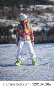 snowboarder on slopes in the sunny morning