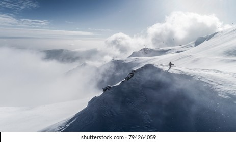 Snowboarder on top of the mountain. Climbing the summit wit a snowboard. freeride on the big mountains. freerider on the peak. Big mountain. ski resort. Romania. Sinaia. Aerial View. Panoramic view.