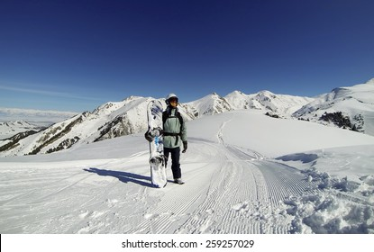 Snowboarder on the top of the mountain in Karakol, Kyrgyzstan