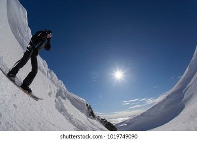 Snowboarder standing on slope