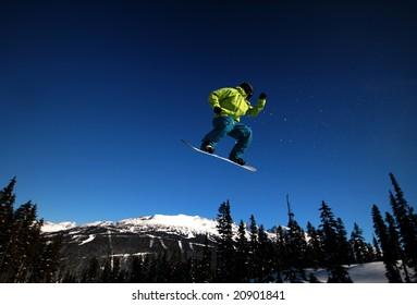 A snowboarder takes flight on Whistler Mountain.