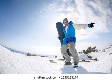 Snowboarder at the top of the mountain. Sheregesh resort.