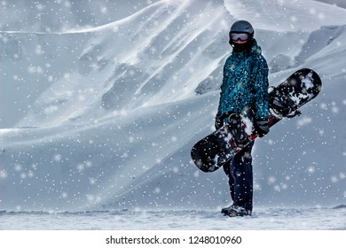 Snowboarder in the top mountains with snowbord. Extreme feeride concept. Space for text
