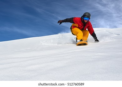 snowboarder very quickly goes down the slope freerider