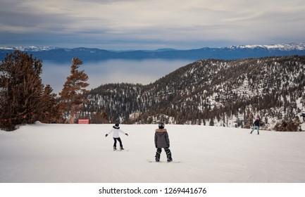 Snowboarding Lake Tahoe California.  Heavenly Ski resort in the winter.