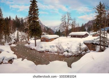 snowbound huts at river bend weissach, near kreuth, dreamy winter landscape upper bavaria
