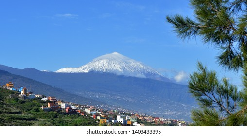 snowcapped mount Teide with villas in foreground. tenerife