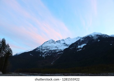 snow-capped mountain with clouds