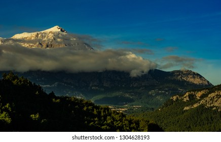 Snow-capped Mountain Peak with Clouds